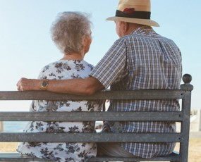 Older couple enjoying time together at the coast