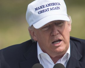 Banner of President Donald Trump wearing a 'Make America Great' hat