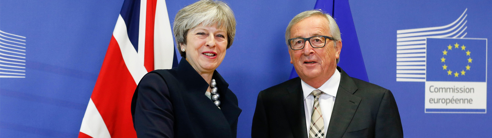 Prime Minister Theresa May and European Commission President Jean-Claude Juncker stand together